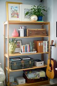 living room wooden living room shelf decorating with boxes storage and frame picture plus blue