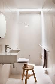 Wooden bathroom stool   Image via Robson Rak