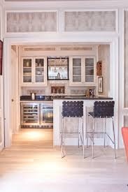wet bar cabinet designs home bar transitional with stainless steel appliances bar sink bar stools
