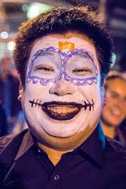 anese man with sugar skull makeup dia de los muertos