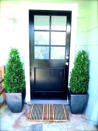 black front doors with glass wood entry panels wooden door panel combined potted plants brown windows w