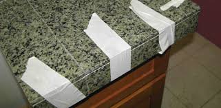 applying granite tile to a countertop edge