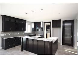 On a much smaller scale, this is our kitchen! Dark cabinets, gray spate  floors, light grey walls and beautiful grey subway tiles.
