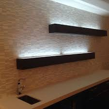 floating shelves with glass top with led lighting to showcase the bottles in your bar area
