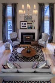 contemporary living furniture. metallic floortoceiling curtains hang in this twostory living room contemporary furniture