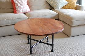 diy round cocktail table with reclaimed wood top and black pipe legs for living room with cream microfiber l sofa and carpet tiles ideas