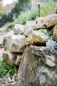 how to build a boulder retaining wall