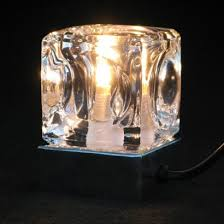 a fantastic feature during the day and striking light at night this ice cube table lamp has a touch sensitive chrome base so it s easy to switch on and off