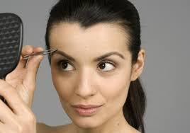 how to trim bushy eyebrows. exotic beauty looking mirror and tweezing eyebrows how to trim bushy