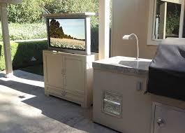 sunbrite outdoor tv installed in outdoor tv lift motorized