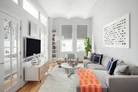 narrow living room with white walls and grey furniture