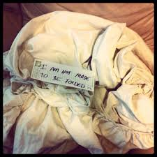 fold fitted sheet husband makes defeated sign for fitted sheet someecards laundry