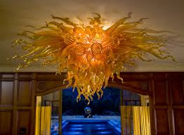 private collector s estate tulsa oklahoma robert kaindl art glass chandelier installation celebration series amber gold flush mount chandelier classic