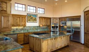 kitchen with emerald green granite countertops and solid wood cabinets