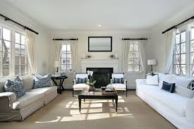 simple living rooms. Exellent Rooms This Living Room Is A Beautiful Example Of Simple Elegance The  Traditional Symmetrical Placement The Couches And Armchairs Allow For Conversation As  In Simple Living Rooms I