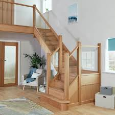 the sheer beauty and simplicity of the glass and oak staircase brings a touch of modern art to this family home
