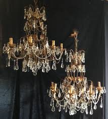 a pair of antique italian gilt chandeliers