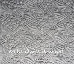 Free Motion Quilting Twisted Designs - The Quilt Journal & A picture of free motion quilting twisted diamond design with pebbling in  alternating diamonds stitchded in Adamdwight.com