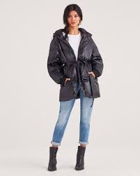 hooded belted down parka in black