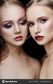 art makeup two s hugging lots of rhinestones of diffe shapes beautiful face smooth skin care beauty makeup on the face of two women close up