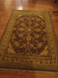 shaw regal heritage area rug with non slip pad