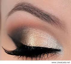 eye makeup black and gold dress