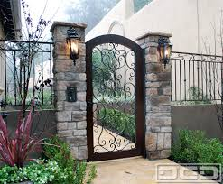 Mediterranean Garage Doors With Matching Wood & Wrought Iron ...