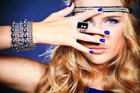 image of a blonde woman wearing blue with various pieces of jewelry