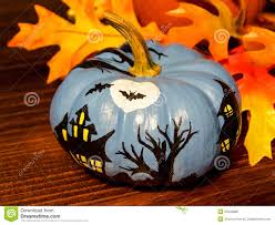 y haunted house scene painted on miniature pumpkin
