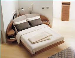 Cozy, change the lines of the room, and efficient use of what would  otherwise be dead space. corner bed ...