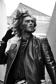 justin wears vest sadotna jumper and leather jacket alexander mcqueen