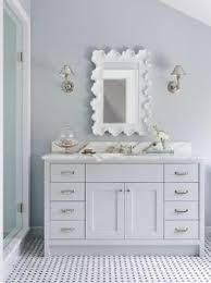 bathroom features gray shaker vanity: master bathroom features a single vanity divided into his and her sections situated under window dressed in ivory linen roman shade flanked by black