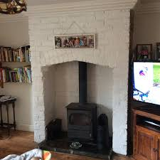 We opened up the fireplace to install multi fuel stove to find an old  hidden fireplace as shown. It was exposed brick ...