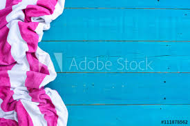 Blank rustic teal blue wood beach sign with pink and white striped