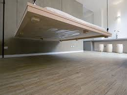 raised floor bed. Plain Bed In This Small Apartment The Bed Can Be Hoisted Up To Ceiling Make For Raised Floor Bed