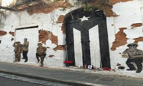 the famous door in old san juan now has the puerto rican flag painted in black and white as a sign of mourning and resistance