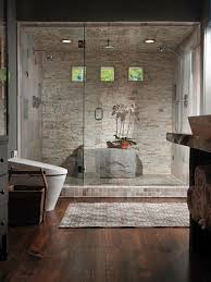 stone-clad steam room with a shower and a large stone instead of a bench