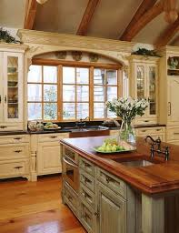 Lie the cabinets and island and the counter color. Maybe we can paint our  island  French Country KitchensCountry ...