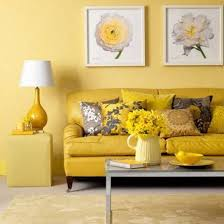 cozy living room interior design ideas with yellow sofa furniture and some cushions also white fl wall art at yellow wall