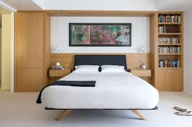 built in wardrobe and shelving around the bed small master bedroom design decor bedroom small master