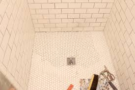 the grit and polish hexagon tile shower floor re do