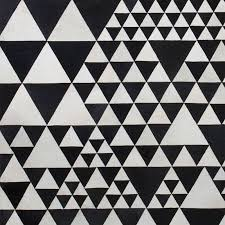 pyramid leather rug by linie design black white pattern close