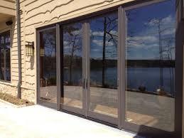 photos of retractable glass patio doors