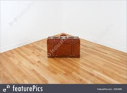 fashion accessories just arrived or leaving vintage leather suitcase in an empty corner of