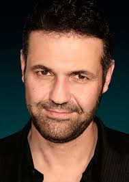 the kite runner author khaled hosseini on piracy farsi and  khaled hosseini photo getty images