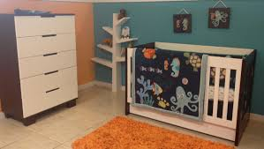 Baby Nursery Room Decoration With White Crib By Babyletto On White Ceramics  Floor Plus Orange Carpet Matched With Orange And Blue Wall Plus White  Baseboard ...