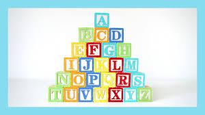 learn the alphabet alphabet pyramid with mi toys wooden blocks