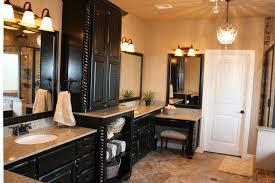 black bathroom vanity. cream wall paint black real wood vanity with storage drawers lamp mirror dark frame bathroom