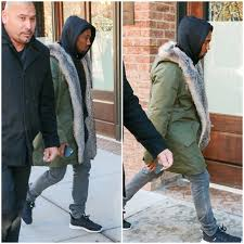 kanye west wears apc fur lined parka jacket with adidas hoo and sl loop sneakers