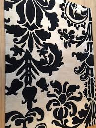 black white 100 wool damask rug 120cmx170cm good condition